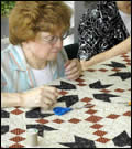 A woman quilting.